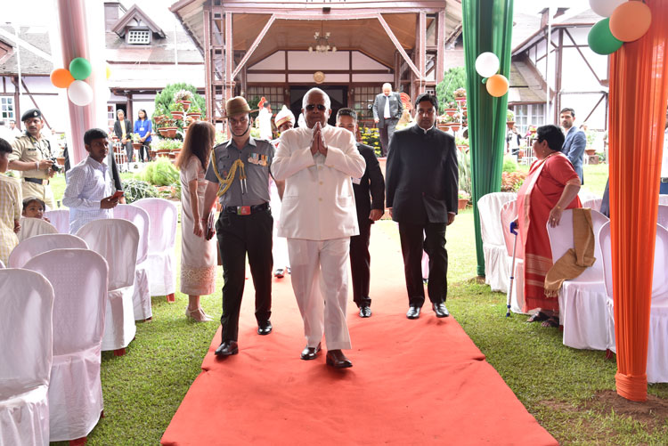 Hon'ble Governor Shri Tathagata Roy greets the people as he walks at Raj Bhavan, Shillong on the 15th August 2019
